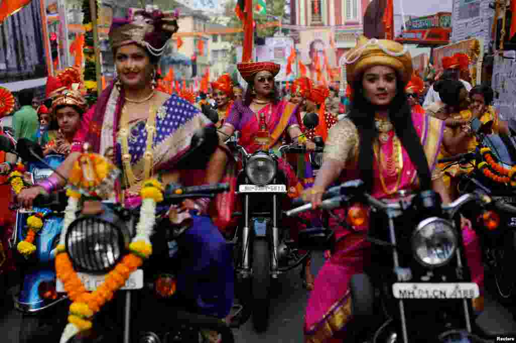 Women dressed in traditional costumes ride motorbikes as they attend celebrations to mark the Gudi Padwa festival, the beginning of the New Year for Maharashtrians, in Mumbai, India.