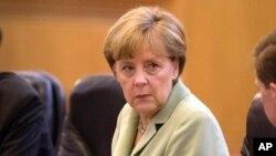 « Nous ne sommes plus au temps de la guerre froide », a rappelé la chancellière allemande, Angela Merkel (Photo AP)