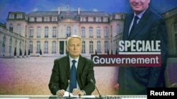 France's Prime Minister Jean-Marc Ayrault takes part in the broadcast news of French TV channel France 2, May 16, 2012 in Paris.