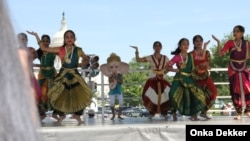 Dancers at the National Asian Heritage Festival in Washington in May, with the Capitol in the background