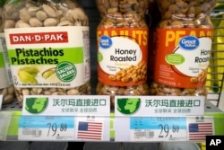 FILE - Imported nuts from the United States are displayed at a supermarket in Beijing, March 23, 2018. China announced a $3 billion list of U.S. goods including pork, apples and steel pipe on Friday that it said may be hit with higher tariffs.
