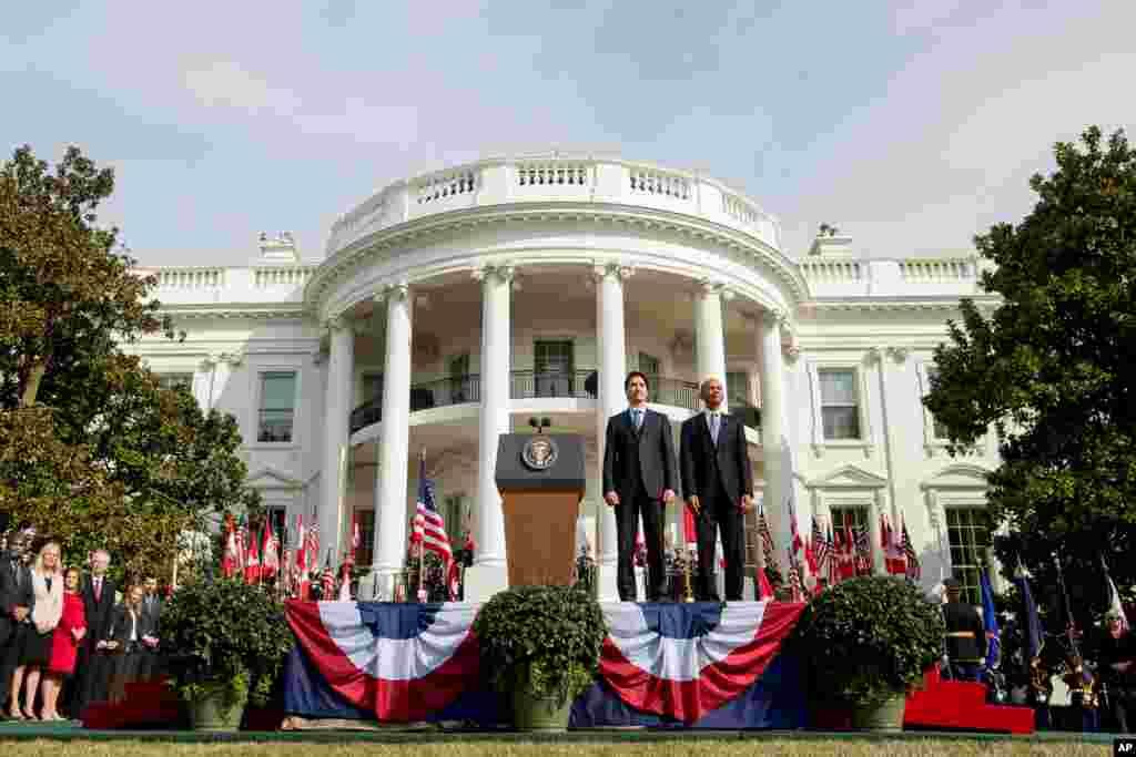 President Barack Obama and Canadian Prime Minister Justin Trudeau stand for the playing of national anthems during an arrival ceremony on the South Lawn of the White House in Washington, March 10, 2016.