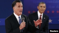 Republican presidential nominee Mitt Romney, left,and President Barack Obama during second U.S. presidential campaign debate, Hempstead, New York, October 16, 2012.