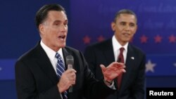 U.S. Republican presidential nominee Mitt Romney (L) answers a question as U.S. President Barack Obama looks on during the second U.S. presidential campaign debate in Hempstead, New York, October 16, 2012.