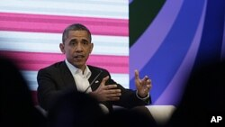 President Barack Obama participates in a three-way conversation with Brazil's President Dilma Rousseff and Colombia's President Juan Manuel Santos, not pictured, at the CEO Summit of the Americas, in Cartagena, Colombia, April 14, 2012.