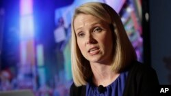 FILE - Marissa Mayer leads the technology firm Yahoo and the list of best-paid women heading U.S. companies.