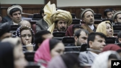 FILE - Afghan parliament members are seen in session.