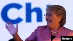 Chilean presidential candidate Michelle Bachelet waves to supporters after leading in the first round of elections in Santiago, Nov. 17, 2013.