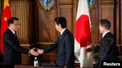 中日韩三国领导人2018年5月9日会后共同见记者(路透社)
