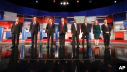 FILE - Republican presidential candidates John Kasich, Jeb Bush, Marco Rubio, Donald Trump, Ben Carson, Ted Cruz, Carly Fiorina and Rand Paul take the stage before the Republican presidential debate at the Milwaukee Theatre, Nov. 10, 2015, in Milwaukee.