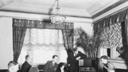 A group of people listening to the radio at the Hamilton Hotel in Washington D.C.