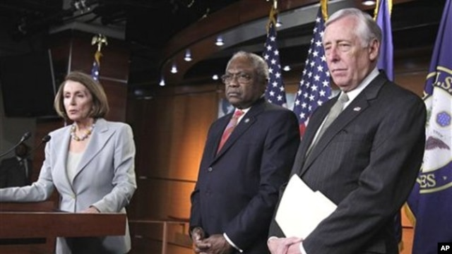 House Minority Leader Nancy Pelosi, left, accompanied by House Minority Whip Steny Hoyer, right, and House Assistant Minority Leader James Clyburn, speaks during a news conference on Capitol Hill, February 18, 2011