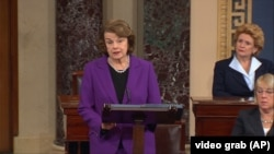 Senator Dianne Feinstein speaks at the Capitol in Washington, Dec. 9, 2014, about the report on CIA interrogation practices.
