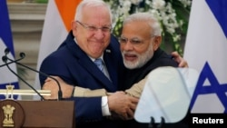 FILE - Israeli President Reuven Rivlin and India's Prime Minister Narendra Modi hug each other after reading their joint statement at Hyderabad House in New Delhi, India, Nov. 15, 2016.