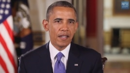 President Barack Obama is seen delivering his weekly address (White House video screen grab).