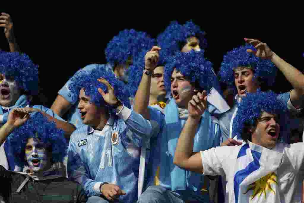 Uruguayan fans cheer before the Copa America final soccer match between Uruguay and Paraguay in Buenos Aires, Argentina, Sunday, July 24, 2011. Uruguay is trying to become the tournament's most successful team, while Paraguay is looking to prove it deserv