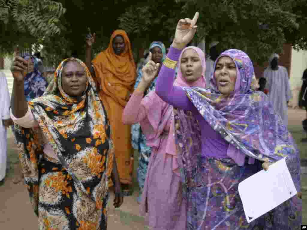 Sudanese women chant slogans during a protest in Khartoum, Sudan, Sept. 14, 2012.