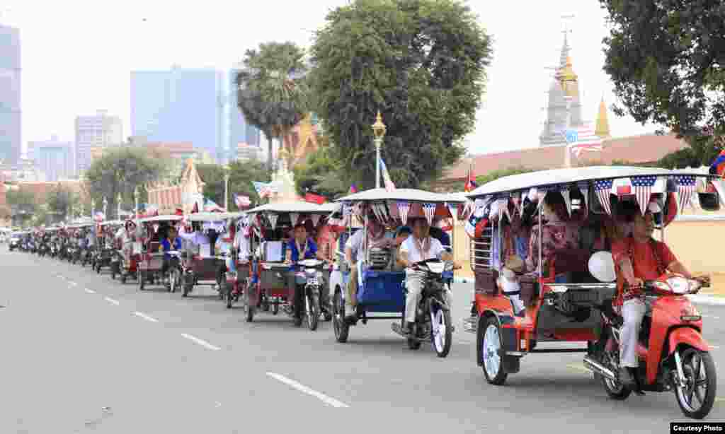 U.S. embassy employees sit in tuk-tuks, decorated with American flags, and kick-off activities marking 70 years of Cambodia-US relations in a parade along the streets in Phnom Penh, 2020. (Photo courtesy of U.S. Embassy in Cambodia)