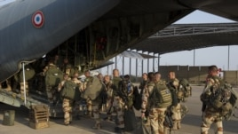 This picture released by the French Army Communications Audiovisual office shows French soldiers boarding for Bamako at N'Djamena's airport, in Chad, Jan. 11, 2013.
