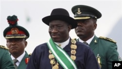 Nigerian President Goodluck Jonathan, center, inspects a guard of honor during his inauguration ceremony at the main parade ground in Nigeria's capital of Abuja, May 29, 2011