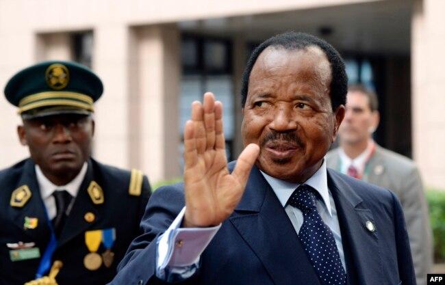 FILE - Cameroon's President Paul Biya waves.