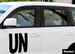 UN inspectors leave the Four Seasons Hotel in their vehicles in Damascus, Syria, Aug. 29, 2013.