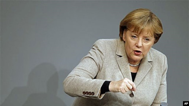 German Chancellor Angela Merkel gestures during her speech at the German federal parliament, the Bundestag, in Berlin, Germany, December 14, 2011.