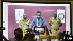 """烏干達歌手出身的反對派議員博比瓦恩2019年5月2日視頻""""出庭""""。瓦恩原名羅伯特森塔穆,他常因批評總統穆塞韋尼而被捕。《華爾街日報》的報道說,警方與華為公司員工合作破解了瓦恩的通訊工具"""