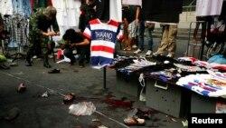 A Thai soldier photographs the crime scene following a bomb blast in Bangkok Feb. 23, 2014.
