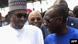 Le président nigérian Muhammadu Buhari et son homologue béninois Patrice Talon le 23 octobre 2018.