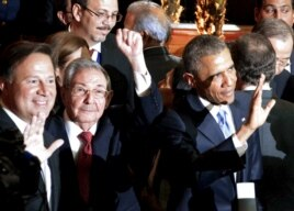 From left, leaders Juan Carlos Varela of Panama, Raul Castro of Cuba and Barack Obama of the United States acknowledge summit cameras in this handout photo, April 10, 2015.