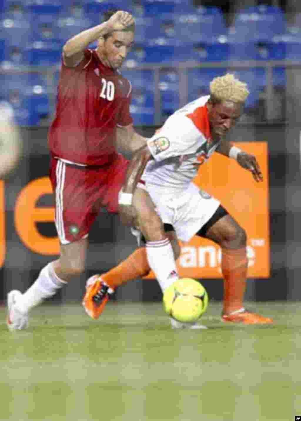 Morocco's Youssouf Hadji (20) is tackled by Niger's Jimmy Bulus during their final African Cup of Nations Group C soccer match at the Stade De L'Amitie Stadium in Libreville, Gabon January 31, 2012.