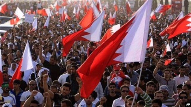 Tens of thousands of Bahraini anti-government protesters jam the main highway in Manama, Bahrain, February 22, 2011