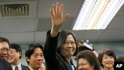 FILE - Taiwan's main opposition Democratic Progressive Party, DPP, Chairperson Tsai Ing-wen waves at the close of a press conference in Taipei, Taiwan.