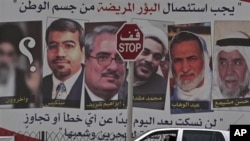 巴林穆哈拉格岛街道旁张贴的被逮捕的反对派领导人画像