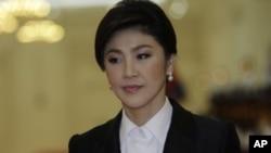 នាយករដ្ឋមន្រ្តីថៃ យីងឡាក់ ស្ហ៊ីនណាវ៉ាត់ (Yingluck Shinawatra)។