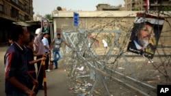 9일 이집트 수도 카이로에서 무함마드 무르시 전 대통령의 지지자들이 시위하고있다.