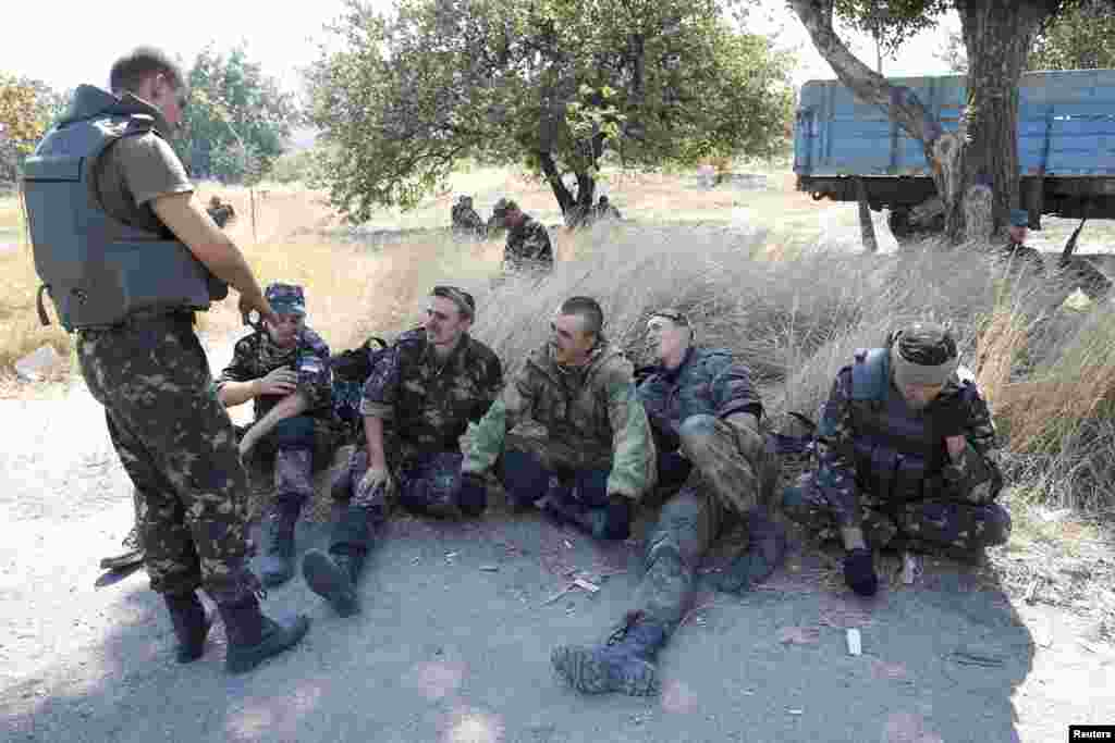 "Soldiers of the Ukrainian self-defence battalion ""Azov"" rest at a checkpoint in the southern coastal town of Mariupol, Sept. 5, 2014."