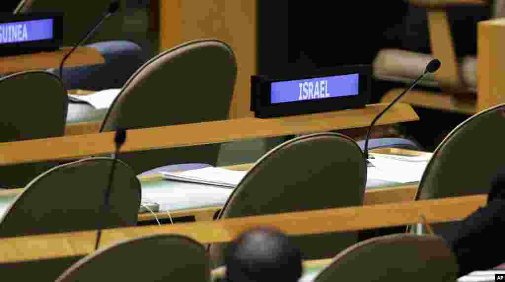 The Israel delegation seats are empty as Iranian President Hassan Rouhani addresses the 69th session of the United Nations General Assembly, at U.N. headquarters, New York, Sept. 25, 2014.