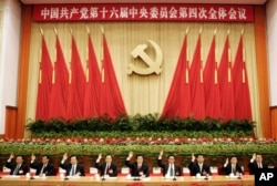 FILE - Senior members of the Standing Committee of the Political Bureau of the Chinese Communist Party are gathered at an assembly in Beijing, Sept. 19, 2004.