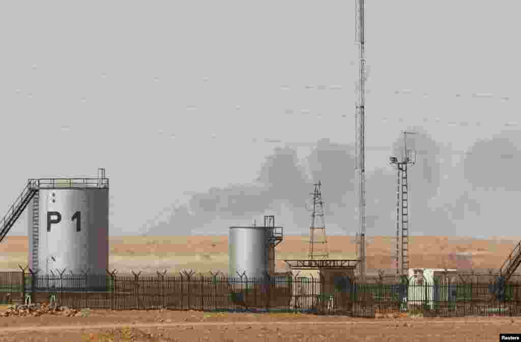 Smoke rises above following demining operations at the In Amenas gas plant January 20, 2013. Algeria said on Sunday it expected heavy hostage casualties after its troops ended a desert siege, but Western governments warned against criticising tactics used