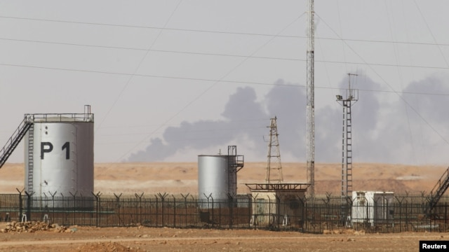 Smoke rises above following demining operations at the In Amenas gas plant, January 20, 2013.