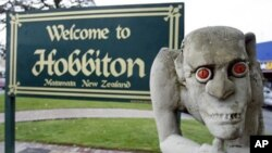 A sculpture of Gollum, the villainous 'Lord of the Rings' hobbit, stands in front of a welcome sign, in Hobbiton Town, Matamata, New Zealand, 21 Oct 2010