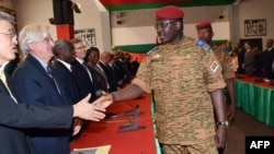 Lieutenant Colonel Isaac Zida, named by Burkina Faso's army as interim leader following the ousting of president Blaise Compaore,shakes hands with ambassadors during a meeting gathering soldiers and diplomats on Nov. 3, 2014 in Ouagadougou.