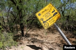 "A warning sign written in Spanish reads ""Watch out! Do not expose your life to the elements. It's not worth it! No drinking water"" on the U.S.-Mexico border on the Tohono O'odham reservation in Chukut Kuk, Arizona, April 6, 2017."