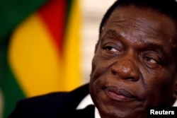 FILE - Zimbabwean President Emmerson Mnangagwa is pictured at a news conference at the State House in Harare, Zimbabwe, Aug. 3, 2018.