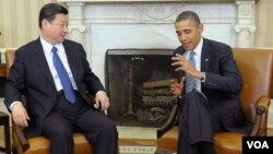 Wakil Presiden Tiongkok Xi Jinping (kiri) dan Presiden Amerika Barack Obama (15/2).