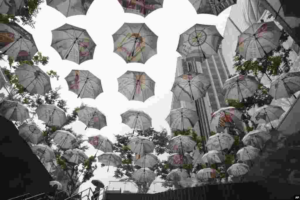 Umbrellas are displayed in front of the City Hall in Seoul, South Korea. The display symbolizes public officials' slogan to be an umbrella or to protect Seoul citizens.