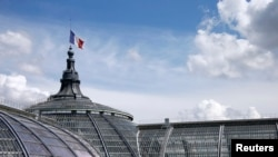 A French flag flying at half-mast at the Grand Palais in Paris, July 28, 2014.