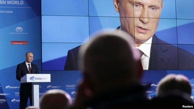 Russian President Vladimir Putin speaks during a meeting in the town of Valdai, Novgorod region, Russia, September 19, 2013.